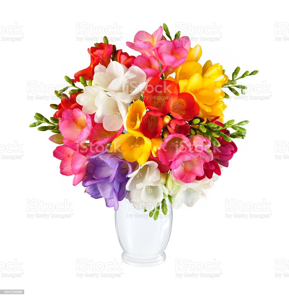 Bouquet of spring flowers in white vase stock photo
