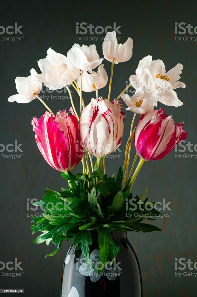 Bouquet of spring garden flowers on cyan background stock photo
