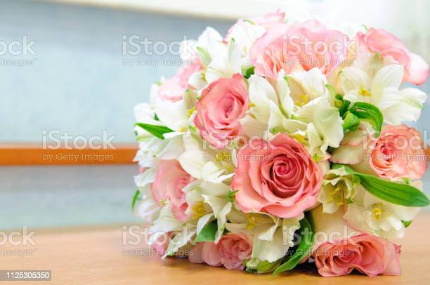 Bouquet of the bride with pink roses on the table beautiful colorful picture id1125305350?b=1&k=6&m=1125305350&s=612x612&h=kriwrqh6w nrhvxkdgcsbv3 agarfbnlfirksalrq9e=