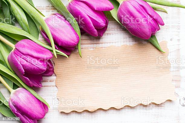 Photo of bouquet of tulips and an empty paper card