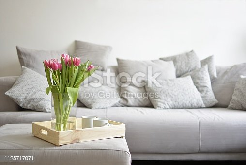 istock bouquet of tulips on a tray and in the background 1125717071