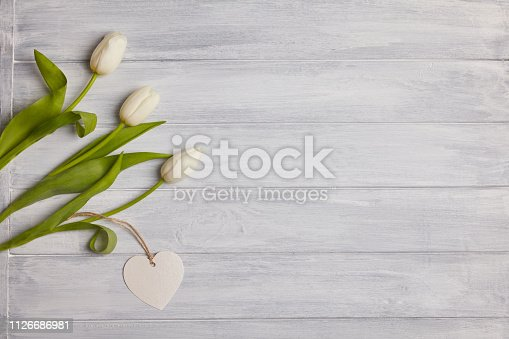 Bouquet of tulips on a  wooden table. Top view. Space for text