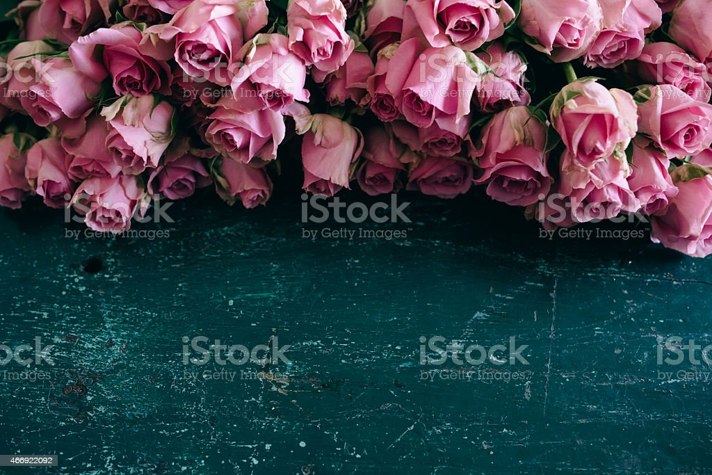 Bouquet of tulips on a wooden table with copy space stock photo