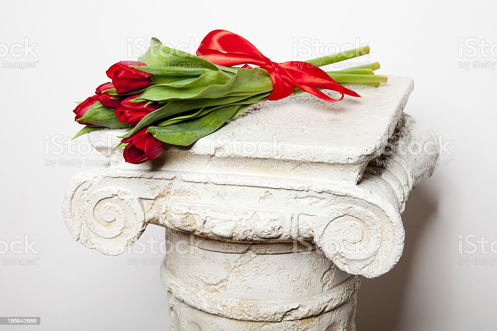 bouquet of tulips on the Greek column XXXL royalty-free stock photo