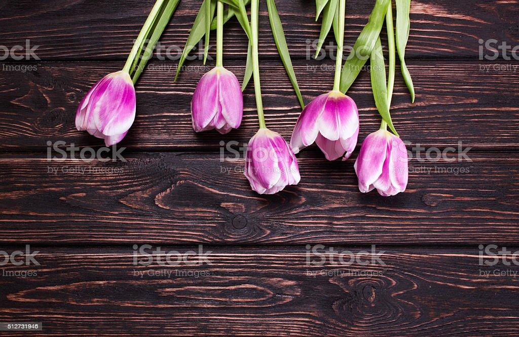 bouquet of tulips on wood stock photo
