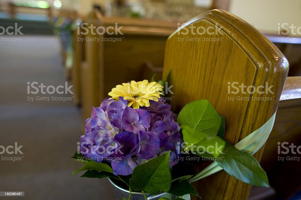 Bouquet of Wedding Flowers Decorates the Church Pews royalty-free stock photo