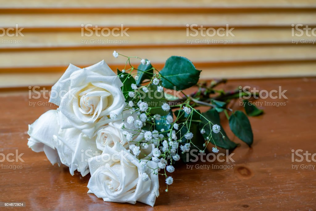 Bouquet Of White Roses With Green Leaves And Small White Flowers ...