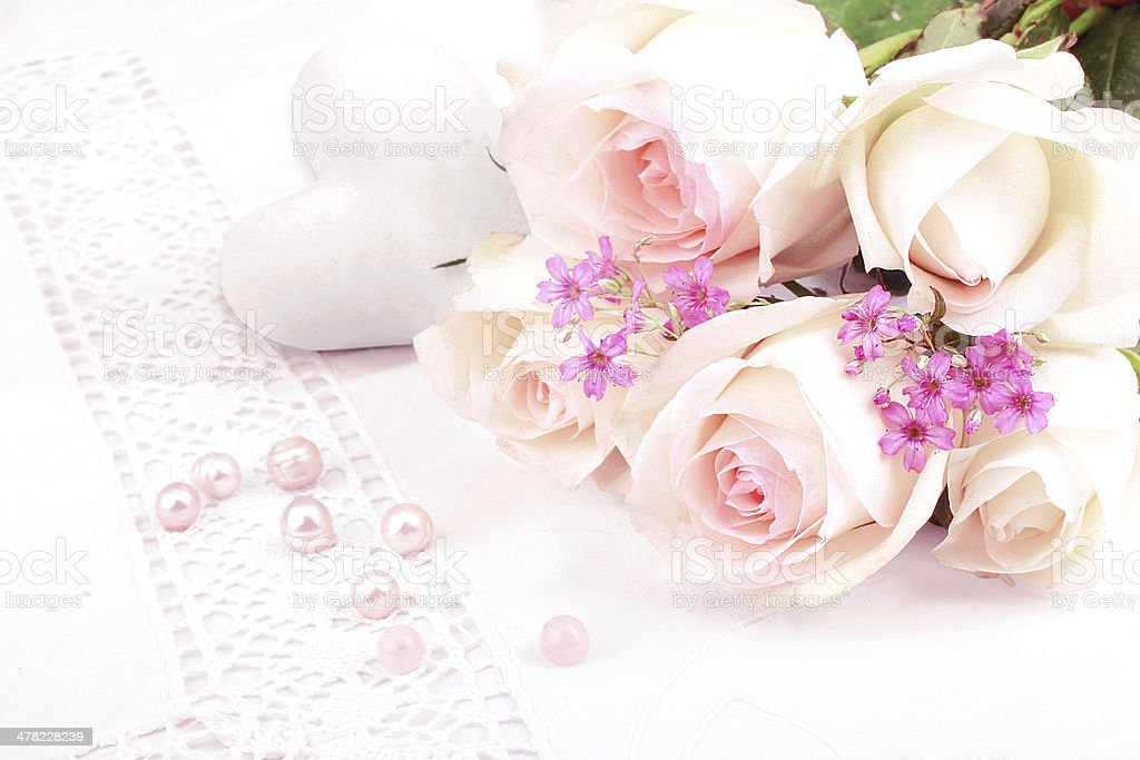 Bouquet of white roses with pearls stock photo