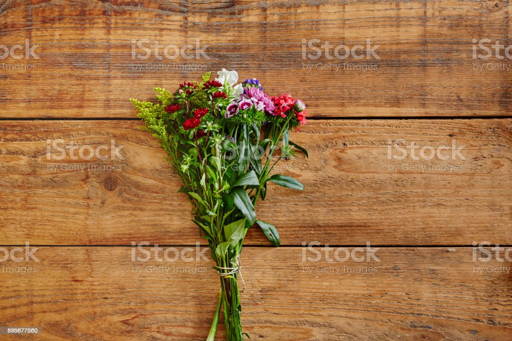 bouquet of wild flowers on wooden table stock photo