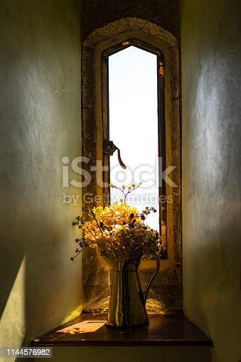 bouquet of yellow flowers on the old window