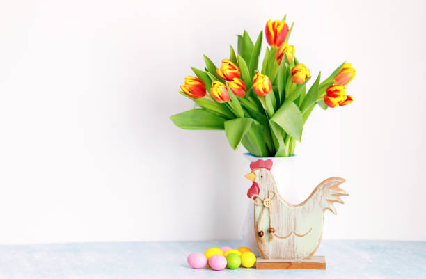 Bouquet of yellow fresh tulips in white jug with painted easter eggs picture id1303038992?b=1&k=6&m=1303038992&s=612x612&w=0&h=e3fiaqw2y0q5wjqc1ip0ojzfnswwpqj0q7ovbdtqlpw=