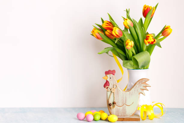 Bouquet of yellow fresh tulips in white jug with painted easter eggs picture id1303039074?b=1&k=6&m=1303039074&s=612x612&w=0&h=wfxh9cfuxmlt42c3slc5s0bzyk6w5oy3trnsr90cdf0=