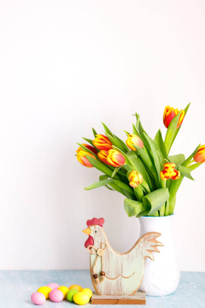 Bouquet of yellow fresh tulips in white jug with painted easter eggs picture id1303039079?b=1&k=6&m=1303039079&s=612x612&w=0&h=lh7acvohpgykc3ci4aiepn9xgnmojq2lk faxe62oqw=