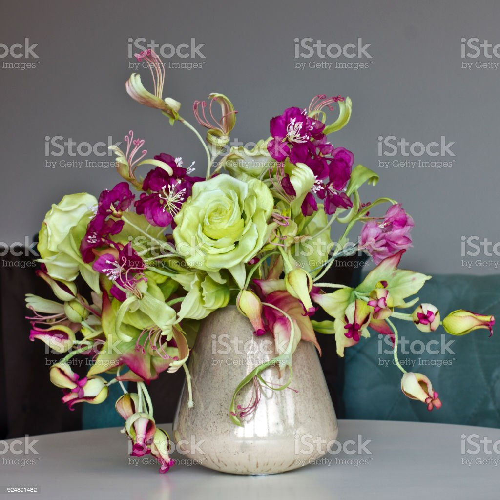 Bouquet Of Yellow Roses With Red Flowers With Buds In Vase On A
