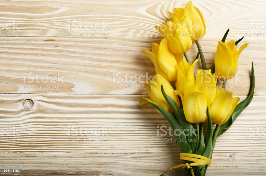 Bouquet of yellow tulips on natural wooden background with space for text zbiór zdjęć royalty-free