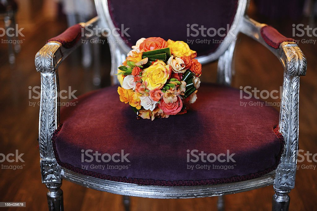 bouquet  on an antique armcahair royalty-free stock photo