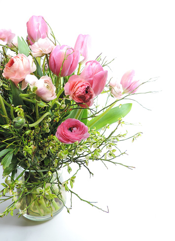 Bouquet of rosé tulips and peonies, isolated on white