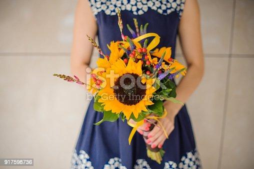 Bouquet sunflowers flower shop female florist holding close up
