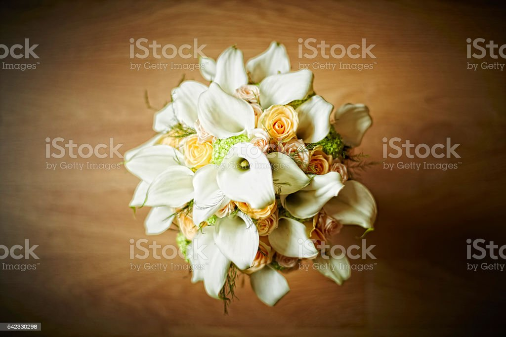 Bouquet with calla lily and orange roses. Aerial view stock photo