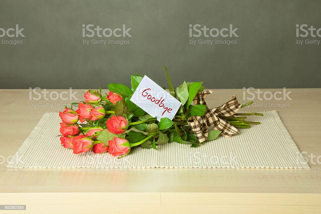 bouquet with goodbye card royalty-free stock photo