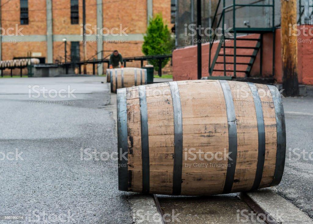 Bourbon Barrels Rolling Down Metal Track stock photo