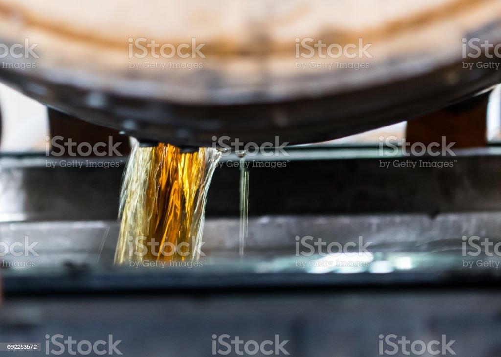 Bourbon Emptying from Freshly Opened Barrel stock photo