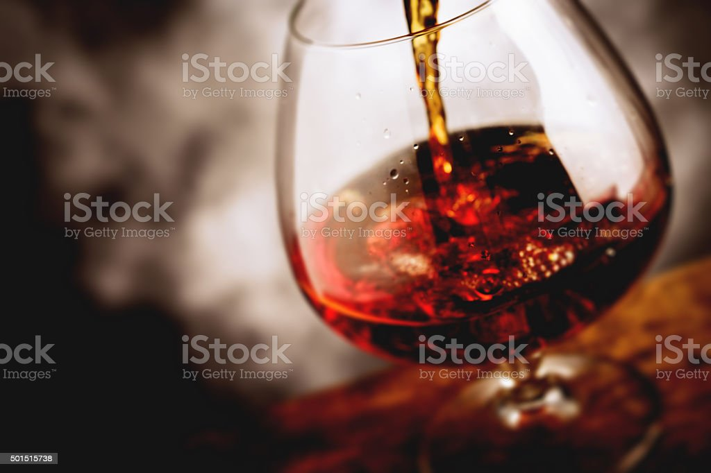 bourbon glass - tilt shift selective focus stock photo