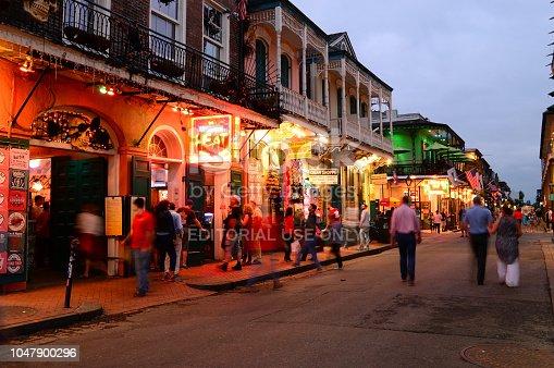 889246424 istock photo Bourbon Street New Orleans at dusk 1047900296