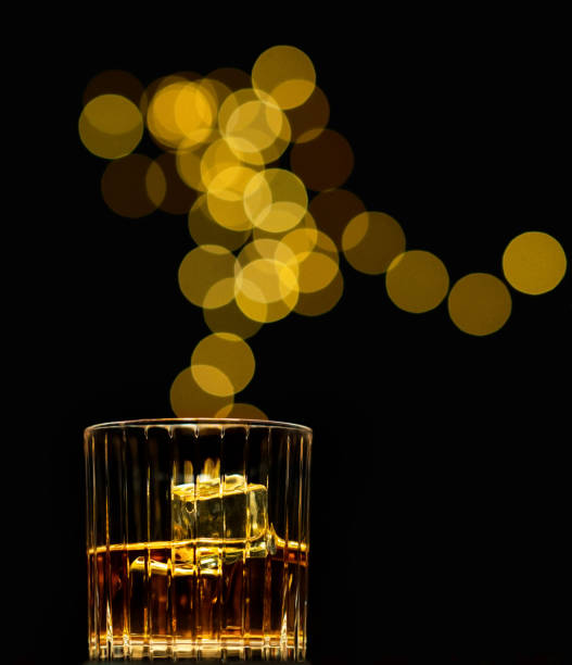 Bourbon Whiskey or Scotch in a Glass with Bokeh in the Background stock photo
