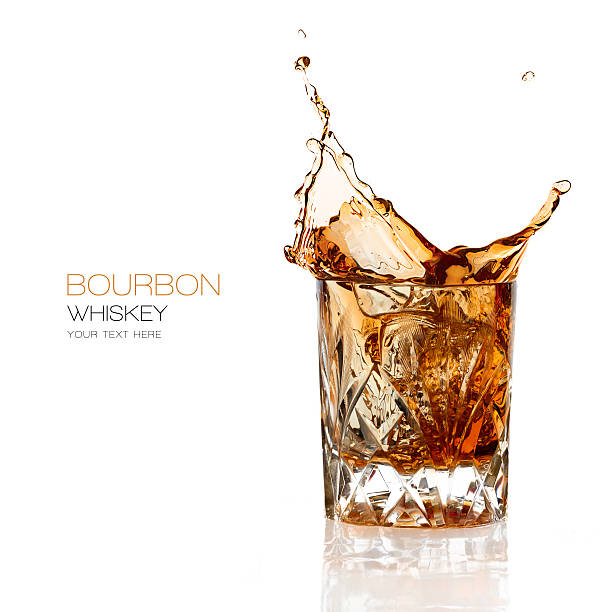 bourbon whiskey splash isolated on white background - rock object stock pictures, royalty-free photos & images