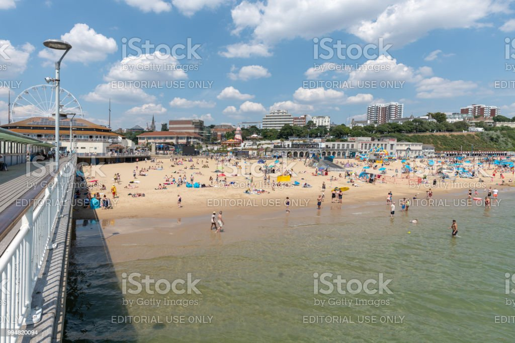 Bournemouth beach full of people by the pier stock photo