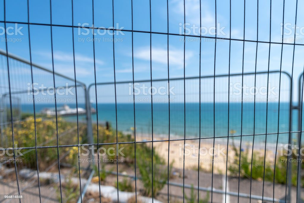 Bournemouth cliff collapse fenced off for safety stock photo