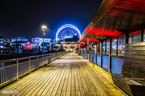 The Christmas ferris wheel in Bournemouth viewed from the pier. Long exposure shot to provide light blur on the wheel.