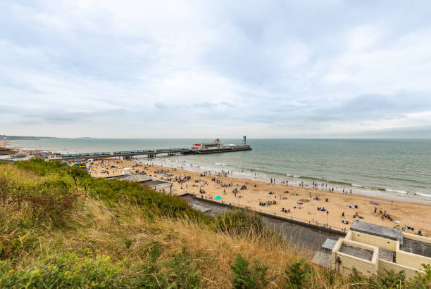 Bournemouth pier and beach on a busy day stock photo