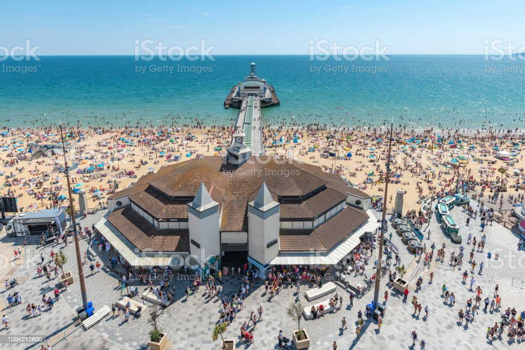 Bournemouth pier and beach with huge crowds on a summer day stock photo
