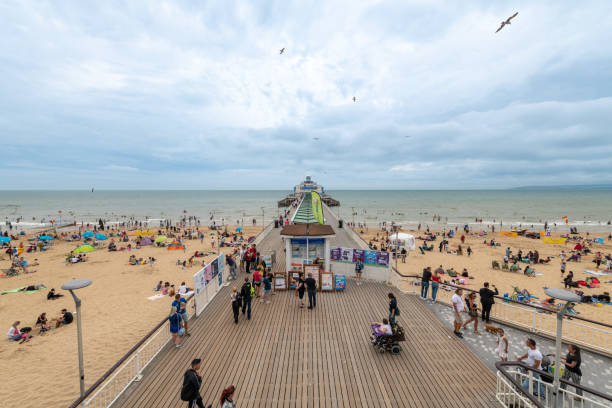 Bournemouth pier on a busy but overcast day stock photo