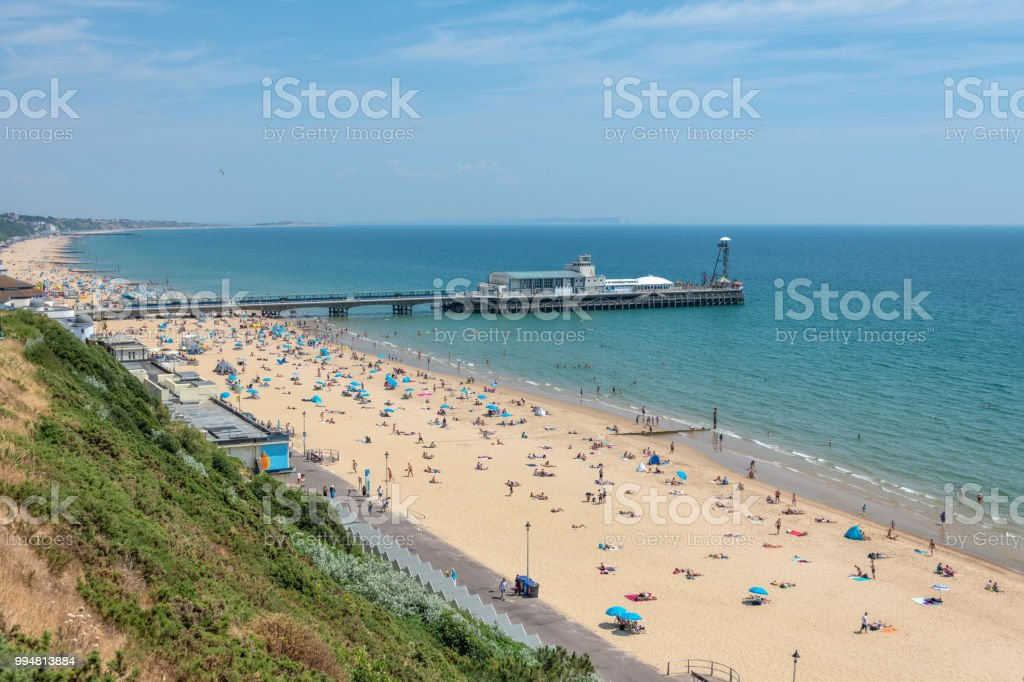 Bournemouth pier with people on the beach stock photo
