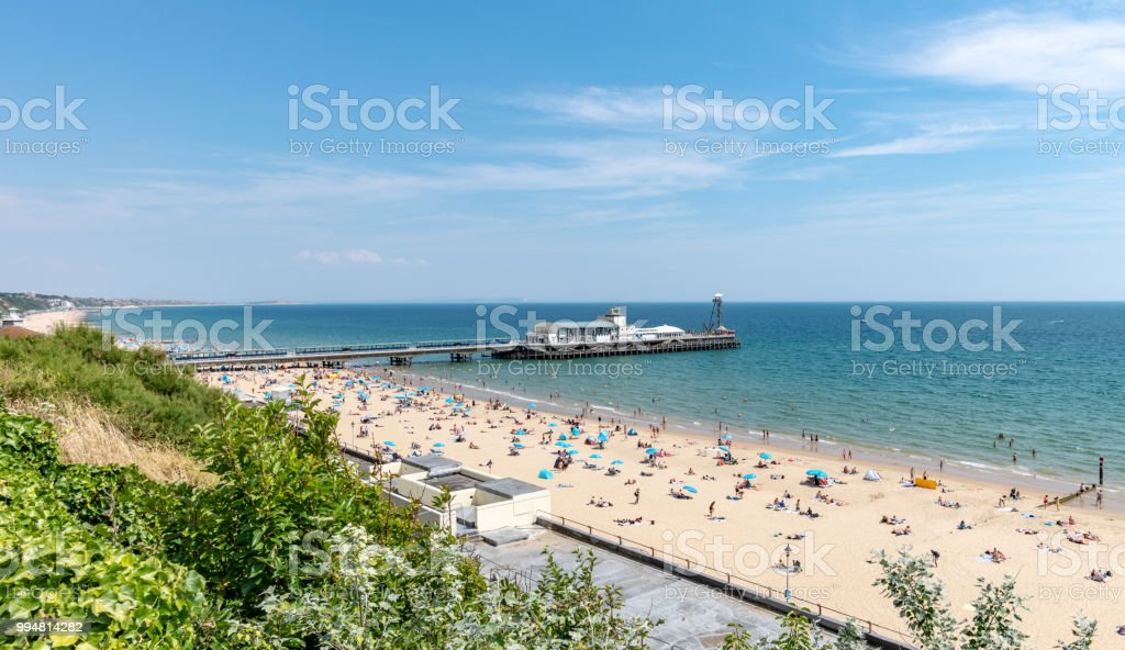 Bournemouth seafront with people on the beach from West Cliff stock photo