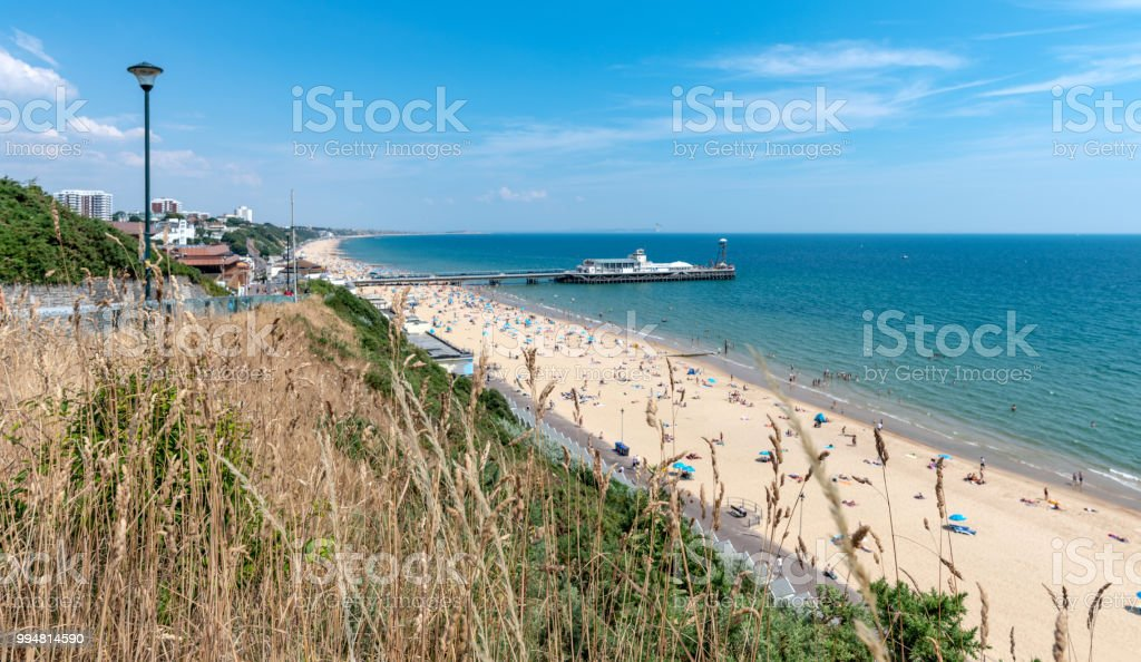 Bournemouth seafront with people on the beach stock photo