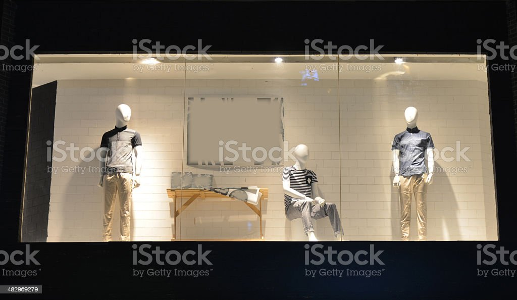 Boutique display window with mannequins stock photo