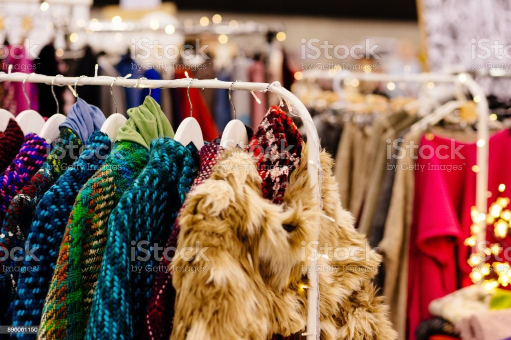 Boutique with winter clothes during sale. stock photo