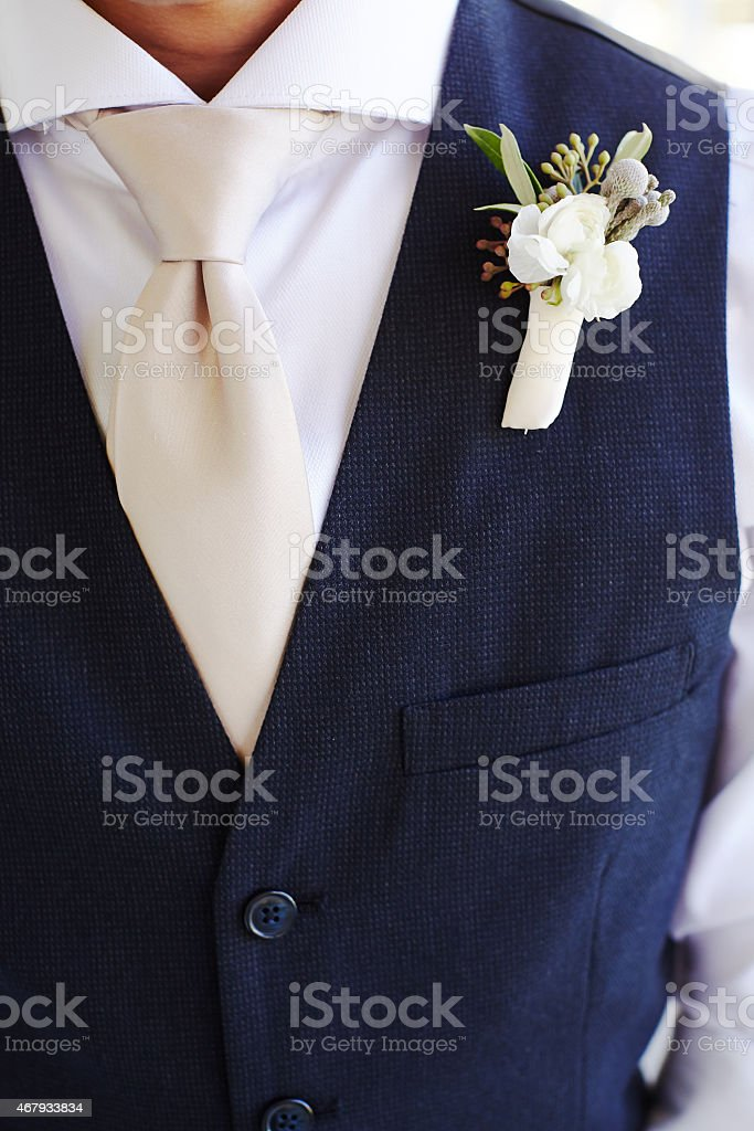 Boutonniere and tux detail stock photo