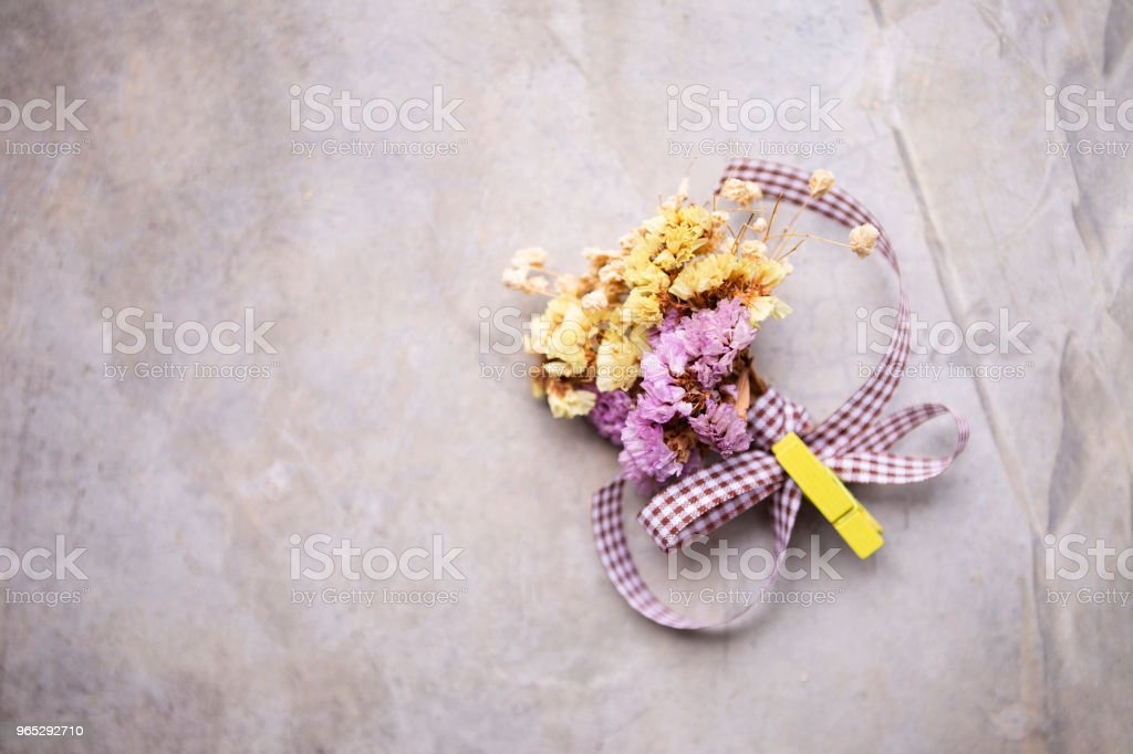 Boutonniere of dry mixed purple and yellow flowers zbiór zdjęć royalty-free