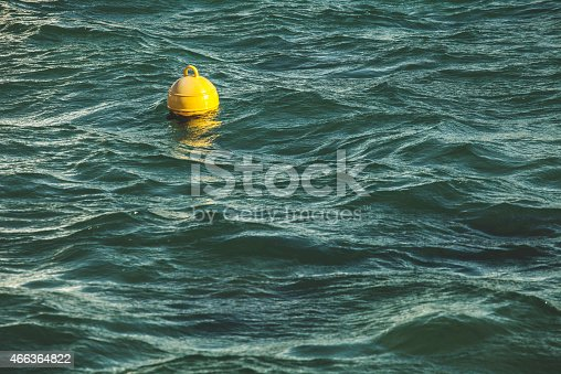 Yellow bouy by the stormy sea