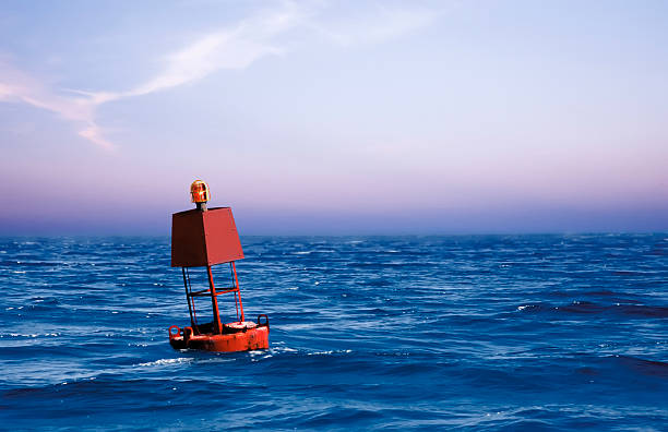Bouy in the Ocean Bouy in the Ocean, Blue Sky buoy stock pictures, royalty-free photos & images