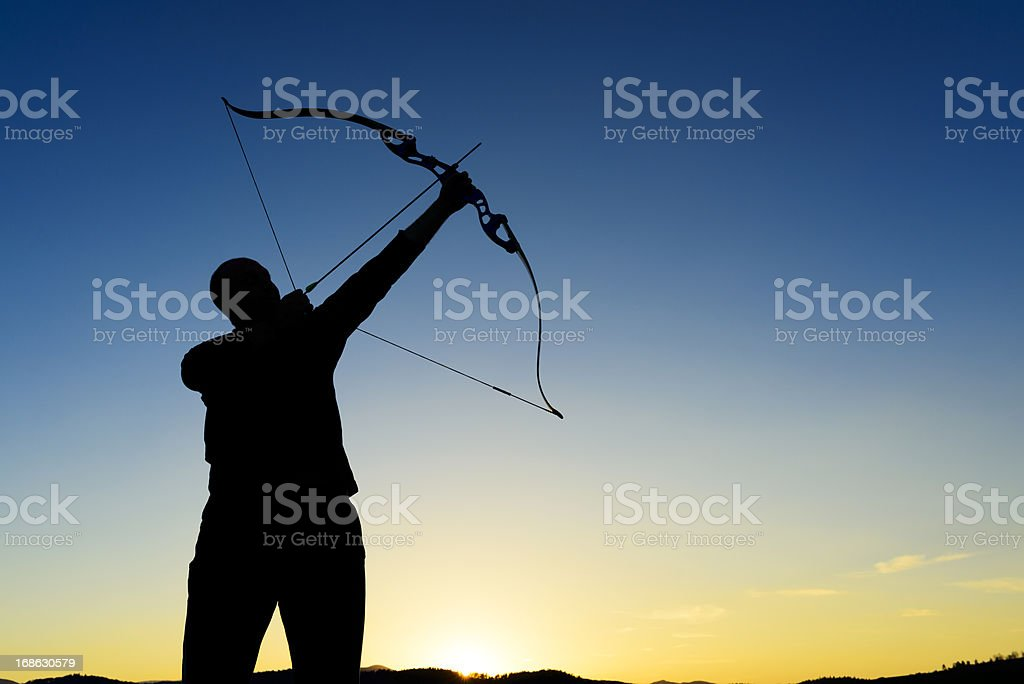 bow and arrow silhouette stock photo