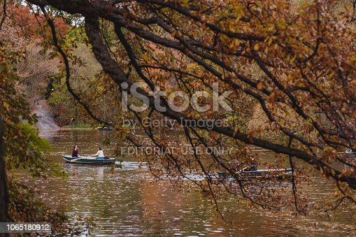 New York City, NY, USA - November 7, 2018: People in a boat in Bow Brige, Central Park, at autumn in Manhattan.