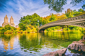 Bow Brige with people in Central Park at autumn in Manhattan. New York City. USA