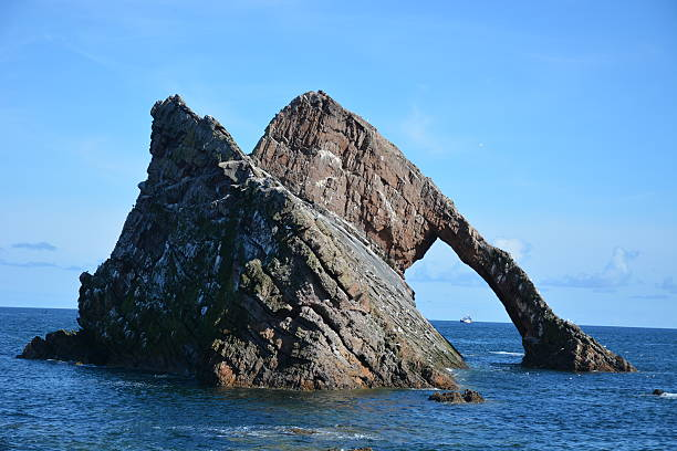 Bow Fiddle Rock and Boat stock photo