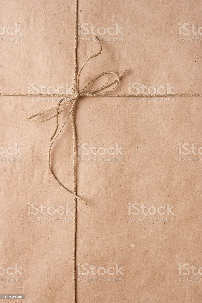 Bow from cord on packing paper stock photo